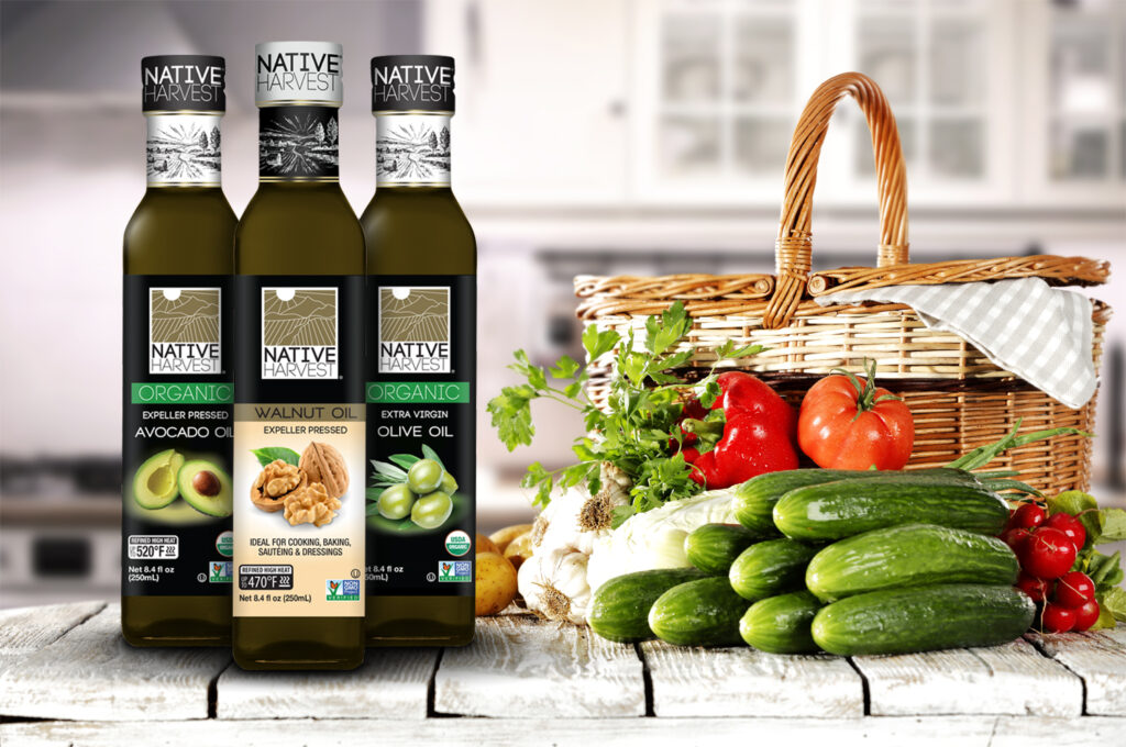 AVO Native Harvest organic and nongmo oils in 250mL square glass bottle lineup new products in kitchen with healthy vegetables